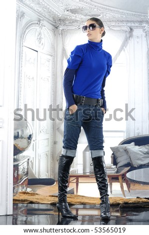 High fashion model in blue dress posing - stock photo