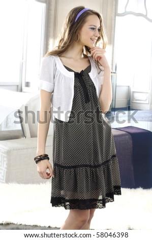 High fashion model in modern dress posing - stock photo