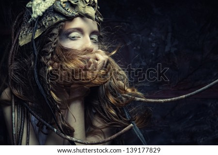 High fashion model with creative hairstyling and bright make up - stock photo