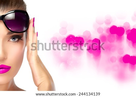 High fashion portrait of beautiful woman's half face holding her shades on forehead while looking at camera. Colorful makeup and manicure. Beauty and fashion concept. - stock photo