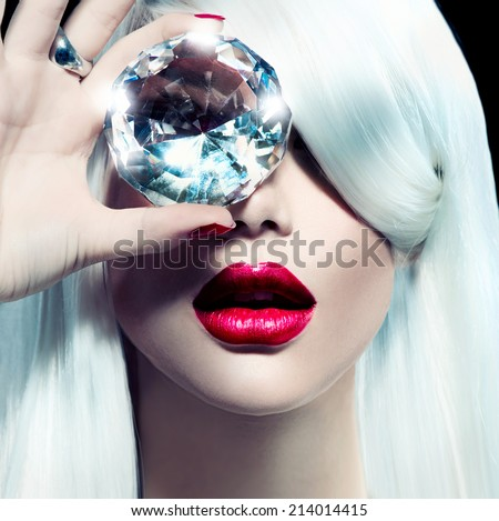 High fashion portrait of beauty model girl with a big diamond. Luxury make-up and accessories, white smooth shiny hair, red sensual lips - stock photo