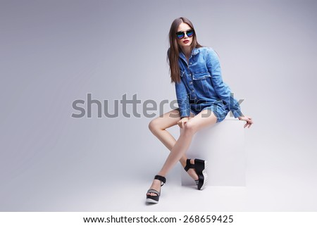 high fashion portrait of young elegant woman. Studio shot  - stock photo
