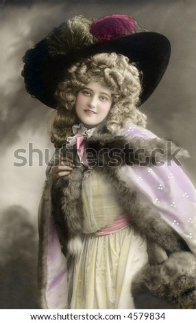 High fashion Victorian dressed woman - circa 1909 vintage hand-tined photo