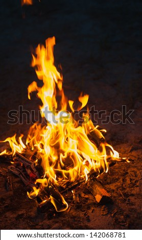 high flame of a bonfire. Fire in night - stock photo