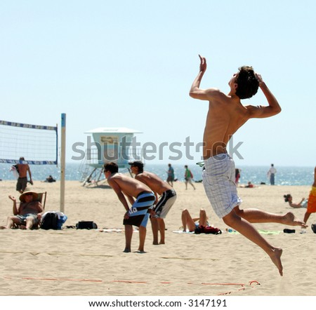 High Flying Serve In Beach Volleyball Match - stock photo