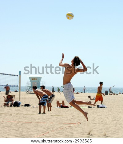 High Flying Server In Beach Volleyball Match - stock photo