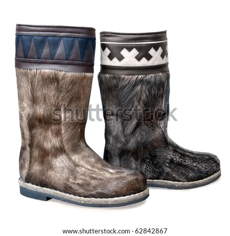 high fur boots, isolated on white boot for north regions - stock photo