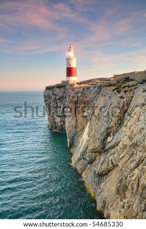 HIGH GROUND TRINITY LIGHTHOUSE OF GIBRALTAR BEACONING IN THE SUNSET  - stock photo