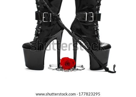 High heel boots with whip, rose and handcuffs, isolated on white background - stock photo