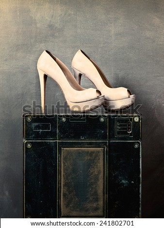 high heel shoes on old speaker in vintage music studio - stock photo