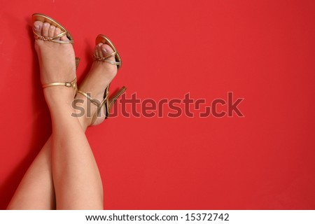 high-heel shoes to up on the red background - stock photo
