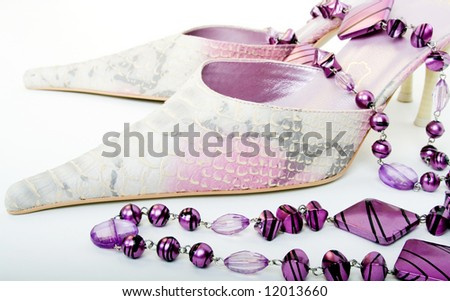 High heel shoes with necklace - stock photo