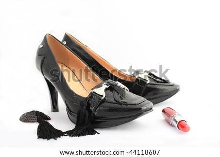 high-heeled shoes in black patent leather, and red lipstick