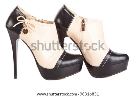 High heels boots on white background - stock photo