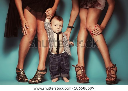 High heels family concept. Stylish baby boy standing with his fashionable mother and aunt. Girls in stylish peep toes shoes. Studio shot - stock photo