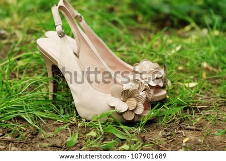 high heels in a green grass - stock photo