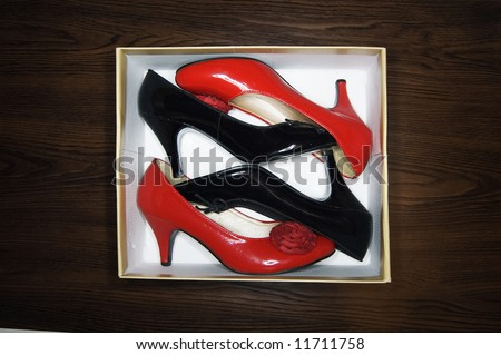 High heels in a shoebox - stock photo