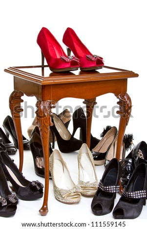 High heels in different colors on table - stock photo