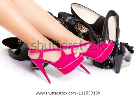 High heels in different colors, womens leg, girls leg, female foot - stock photo