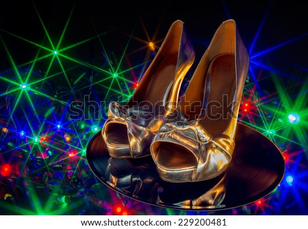 high heels on a vinyl record - stock photo