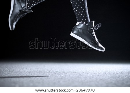 high jumping girl caught with flash - stock photo