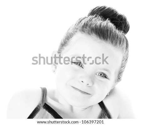 High key image of a beautiful toddler ballerina on white background