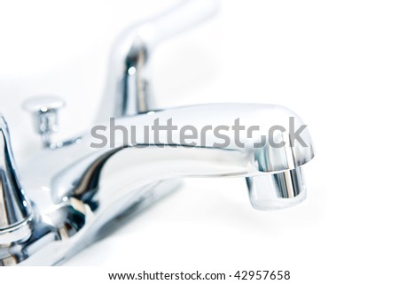 High key image of a faucet on a white background - stock photo