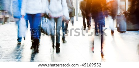 High key image of a group of high school students walking towards the camera - stock photo
