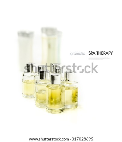 High key image of essential massage oils against a brightly lit background. Concept image for spa treatment menu. Copy space. - stock photo