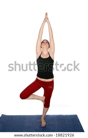 high key image of young woman in yoga pose - stock photo