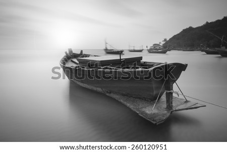 High key ,Long Exposure ,Boats at the beach during sunset black and white tone. - stock photo