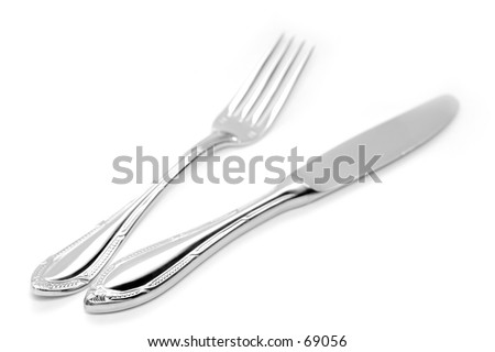 High key photo of isolated silver fork and knife.