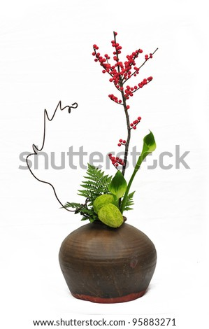 high key photograph of a highly stylized, exotic flower arrangement - stock photo