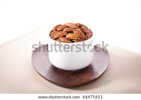 High key picture of pecans in a bowl - stock photo