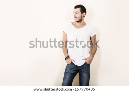 High Key Portrait of a relaxed latin man in casual clothes.