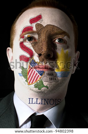 High key portrait of a serious businessman or politician whose face is painted in american state of illinois flag - stock photo