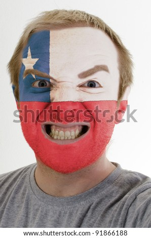 High key portrait of an angry man whose face is painted in colors of chile flag