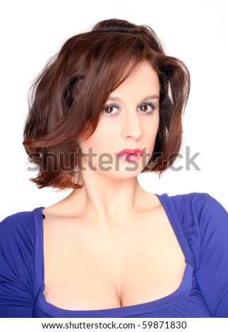 High key portrait of beautiful brunette. Studio shot.