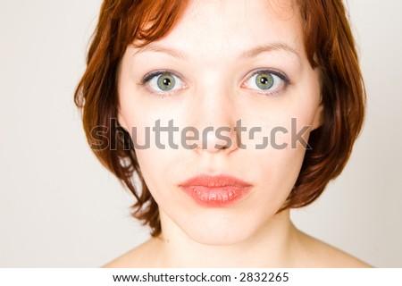 High-key portrait of sad model - stock photo