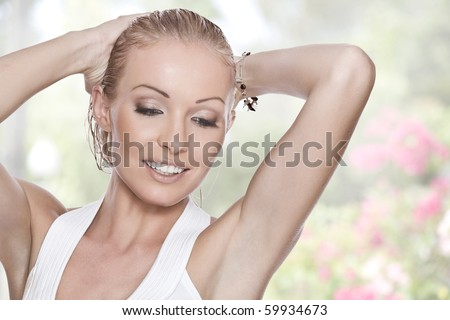 High key portrait of young beautiful woman  in summer environment