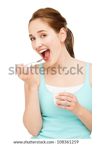 High key Portrait  young caucasian woman eating yogurt isolated on white background - stock photo