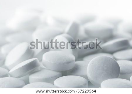 High key shot of white pills brightly lit. - stock photo