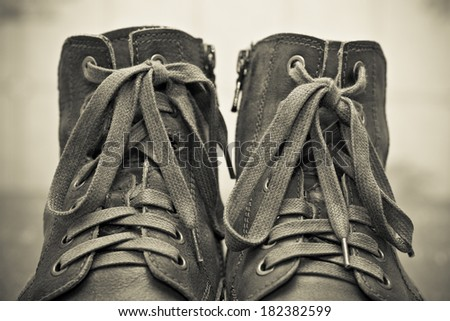 High leather shoes with laces close up. Autumn and spring season . vintage style - stock photo