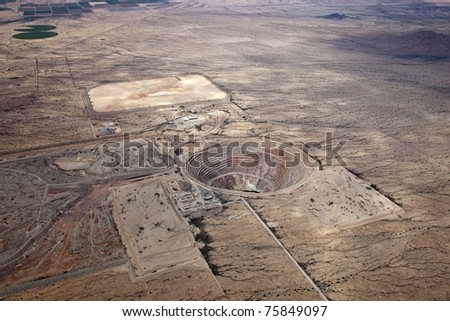 High level aerial look at the Sacaton Open Pit Mine - stock photo