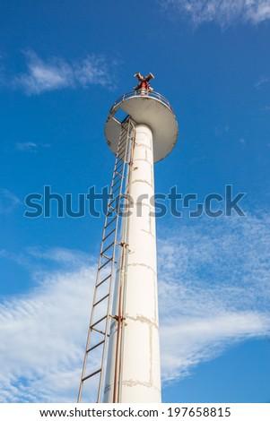 High lifeguard tower under blue sky on beach  - stock photo