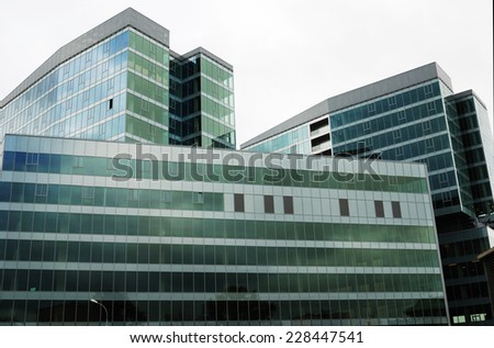 high modern building made of glass and metal - stock photo