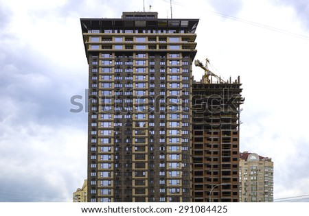 High modern house skyscraper building and blue sky - stock photo