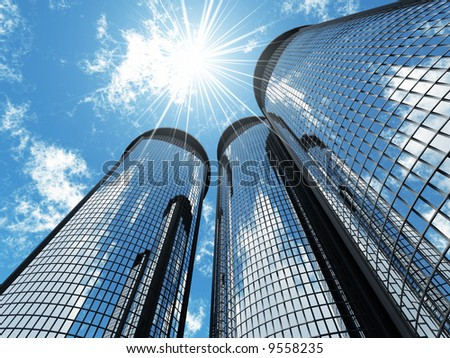 High modern skyscrapers on a background of the blue sky and in solar patches of light - stock photo