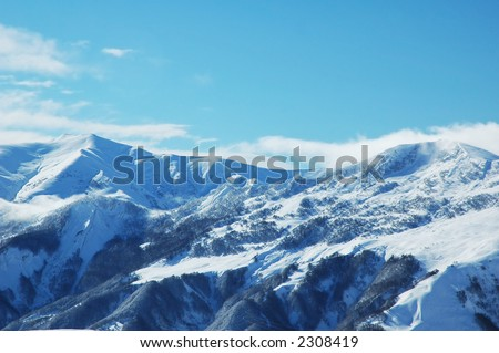High montaines under snow in the winter - stock photo