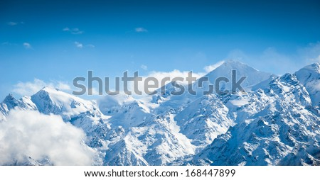high mountain and snow peaks